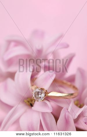 Gold engagement ring on hyacinth