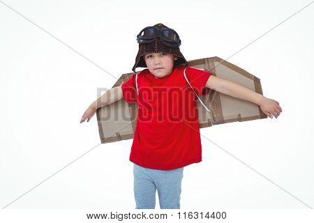Boy pretending to be a pilot on white screen