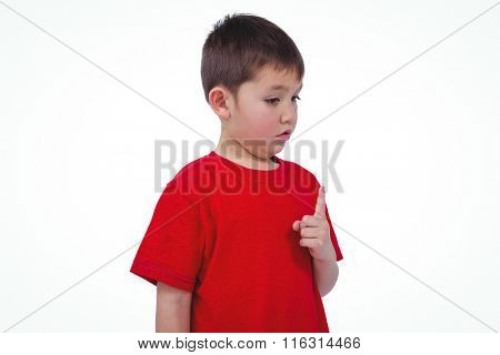 Unsmiling boy on white screen