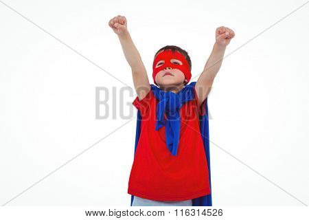 Masked boy raising fists pretending to be superhero on white screen