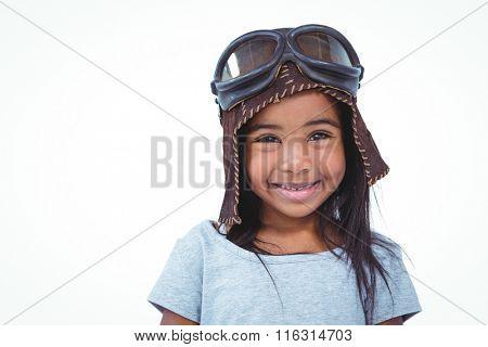 Smiling girl pretending to be pilot on white screen