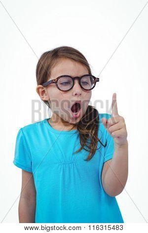 Cute girl shaking finger saying no on white screen