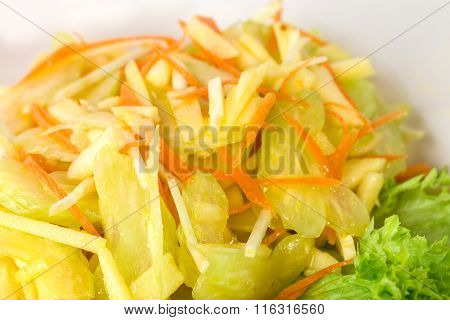Delicious celery salad with grated carrots.