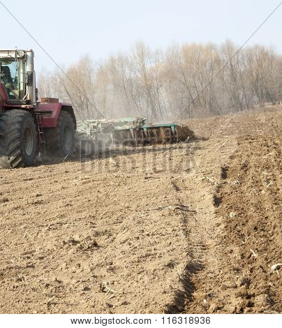 Harrowing The Soil With Disc Harrows