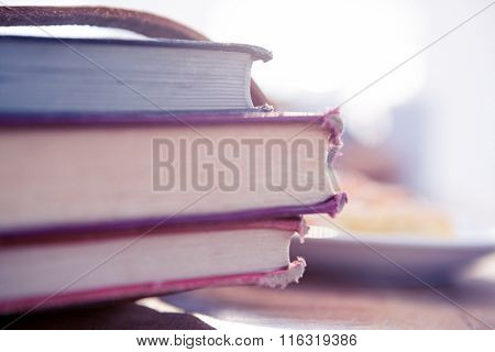 Stack of books on table in brightly lit office