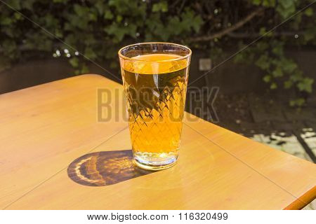 Cidre Glasses Standing On An Outdoor Table In The Sun As Symbol For Hesse Cidre Called Apfelwein