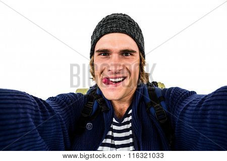 Backpacker holding the camera and grimacing on white screen