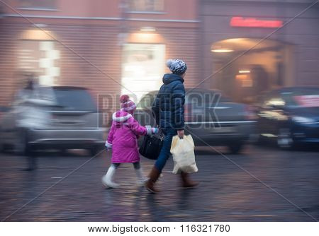 Mother And Dauhgter On The Streets Of The City