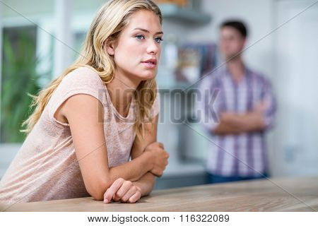 Annoyed couple ignoring each other in the kitchen