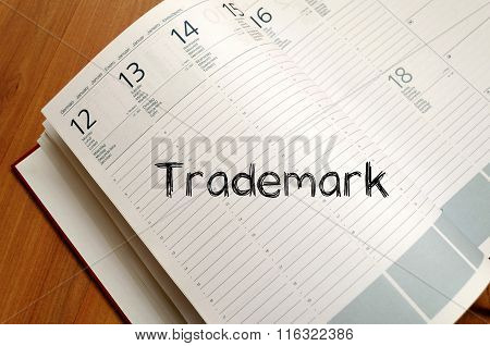 Trademark text concept write on notebook with pen