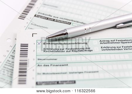 Form of income tax return with ball pen in Germany