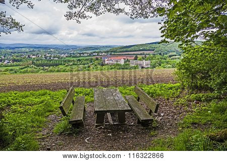 bench with view to Sankt Wendel with cloudy sky