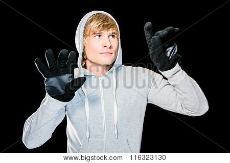 Man with black gloves hitting glass with black background