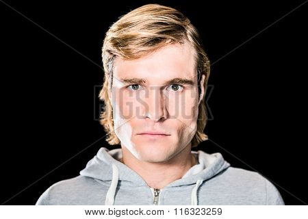 Close up of serious man staring at camera with black background