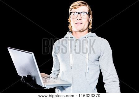 Surprised hipster man staring at camera with black background