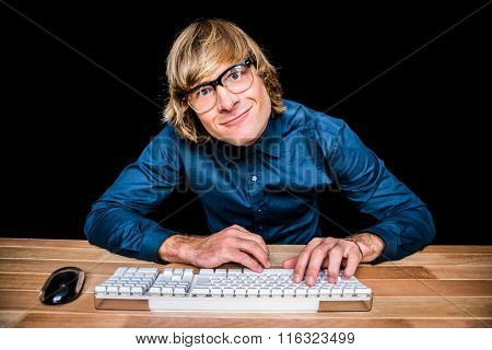 Hipster businessman grimacing at the camera on black screen