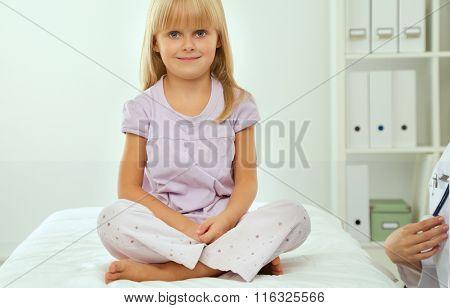 Little girl  in hospital having examination