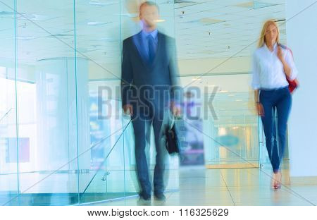 Businesspeople walking in the corridor of an business center