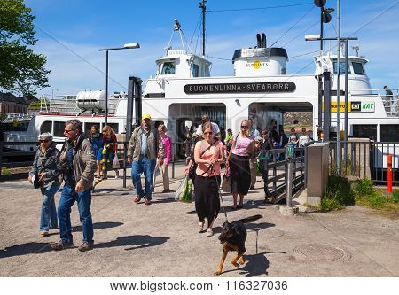 Tourists Descend From The Suokki Ship To The Pier