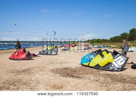 Kitesurfers On The Beach Prepare Sport Equipment