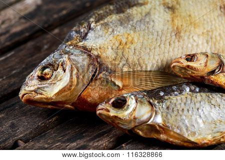 Salted Dry fish vobla on wooden table.