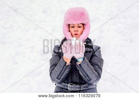 Beautiful Young Women Blowing Snow