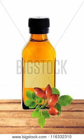 Medicine Bottle With Yellow Syrup And Dog-rose On Table Isolated On White