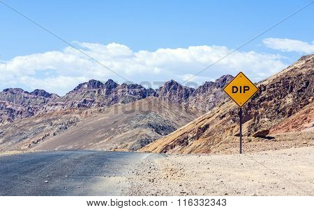 Scenic Road Artists Drive In Death Valley With Road Sign Dip For Hilly Road