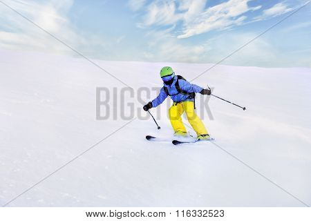 Young Male Sliding Very Fast While Skiing On The Mountain
