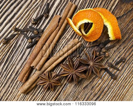 Spices anise, cloves and cinnamon on a wooden table.