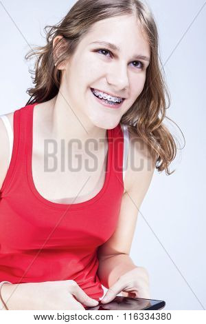 Dental Concepts And Ideas. Caucasian Female Teenager With Teeth Brackets Chatting By Cellphone