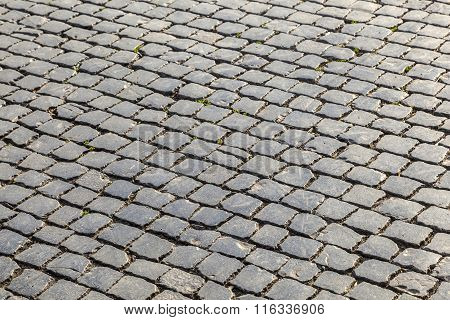 old historic cobble stone street with moss