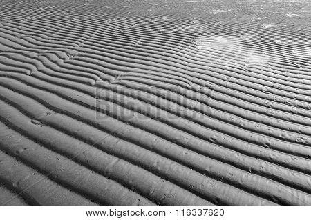 Beach sand waves texture pattern background.