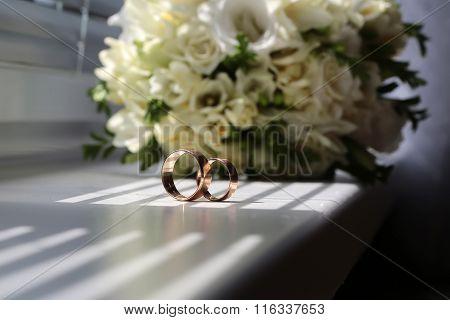 Two Wedding Ring Near Bunch