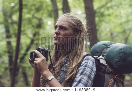 Observing Woman In Forest Holding Camera Ready.