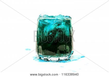 blue coctail drink with ice cubs isolate