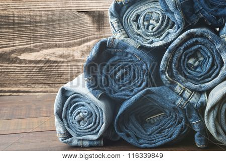 background of a stack rolled jeans