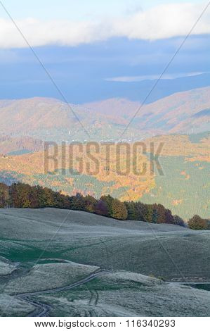 Autumn Mountains Covered With Colorful Forests Panoramic Landscape. Horizontal Panoramic View Overl