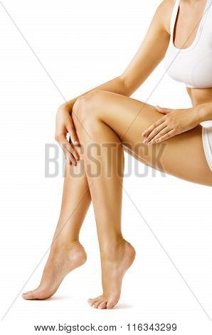 Woman Body Legs Beauty Model Sitting on White background touch Leg Skin