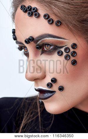 Girl, fashion makeup, black beads on face, dark lips,  portrait.