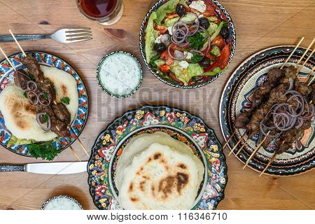 Souvlaki or kebab, meat skewer with pita bread and greek salad