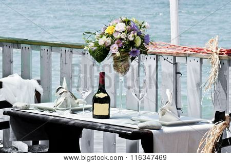 Romantic Lunch By The Sea With Wine And Flowers
