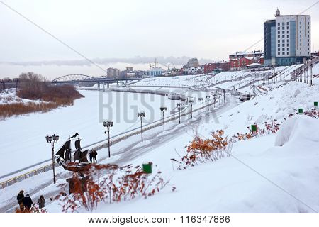 TYUMEN, RUSSIA - JANUARY 6, 2015: People walking at the embankment of river Tura. The first phase of construction of this 4 level embankment was completed in 2012