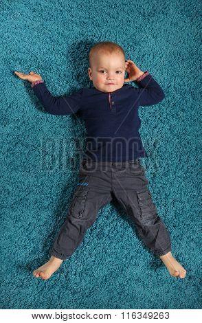 Boy lying on the carpet 2