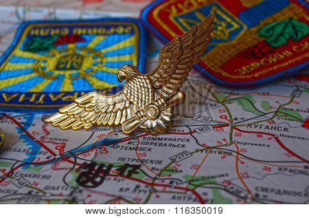 Cockade of Ukrainian Army. Eastern Ukraine map with site of MH-17 flight crash as background. At January 31,2016 in Kiev, Ukraine