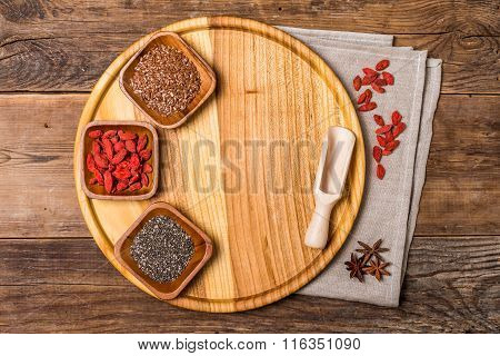 Seeds And Goji In A Wooden Bowls