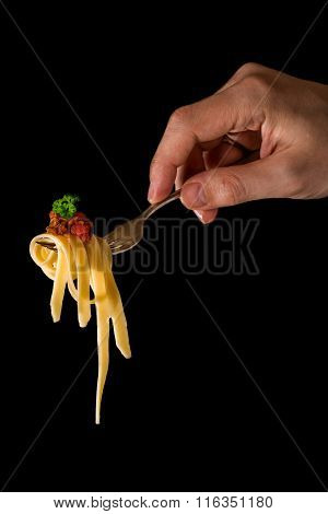Mans Hand Holding A Fork With Pasta