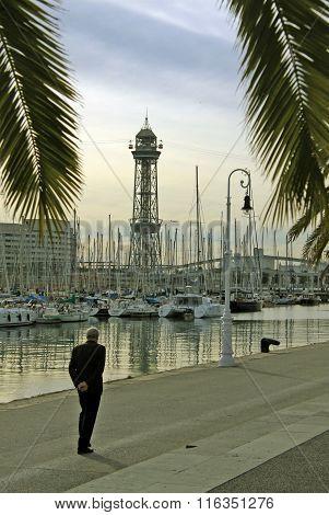 Barcelona, Catalonia, Spain - December 14, 2011: A Man Walking Along The Seaside Promenade At Barcel