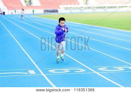 Boy Runnin On Blue Track