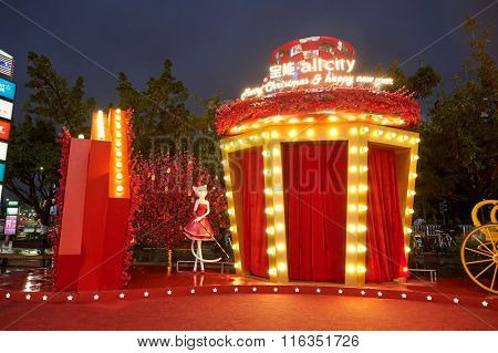 SHENZHEN, CHINA - JANUARY 22, 2016: Christams and New Year decoration in Longgang district at night. Longgang District is one of districts of Shenzhen, China. It is located in northeastern Shenzhen.